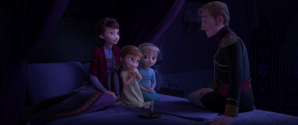 "Young Elsa and Anna listening to a story from their father in ""Frozen 2"""